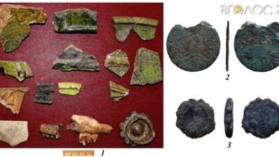 Глиняний посуд, монети, бруківку та рештки поховання знайшли на Замковій горі