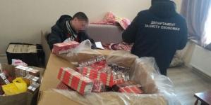Спирт, горілка, цигарки та… артилерійська міна: поліцейські області викрили ще один цех з фальсифікатом