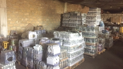 У підприємця з Коростеня правоохоронці вилучили майже 9 тисяч пляшок фальшивої горілки